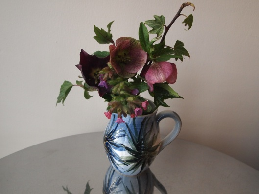 blue jug and small garden flowers
